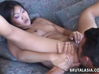 Gorgeous Asian babe with a pair of small natural tits gulps her raunchy lover's thick boner. She sits down on his big fat sausage and rides on it lustfully.