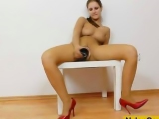 Brunette tantalise fake penis in panty-hose