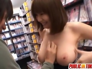 Yuma Asami busty sucks stiffy at shop