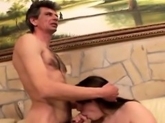 Busty brunette rides an amputee in this weir scene