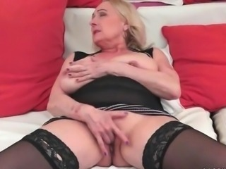 Busty granny masturbating and riding big cock