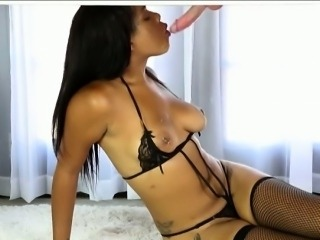 Ebony masseuse jerks and milks cock under the massage table