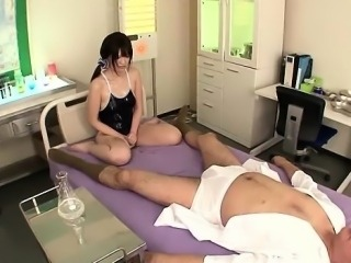 Akane Azusa rubs cock with oiled tits
