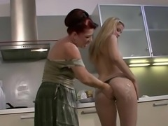 She dildoing her aged peach onto A kitchen