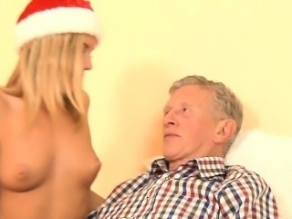The clumsy young lady Santa eating an old dick
