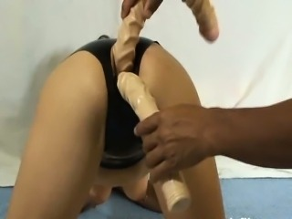 Three giant dildos stuffed in her mutilated asshole