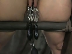 Redhead submissive gets clit clipped