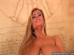 Big titted soccer mom is toying her shaved pussy free