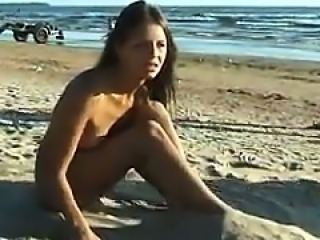 Beautiful Naked Girl At The Beach
