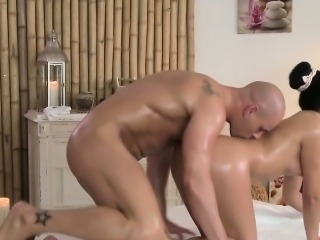 Masseuse oils and fucks thick dick on a massage table