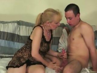 Granny enjoying hot sex with a boy