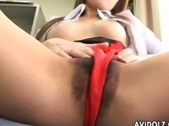 Asian babe is rubbing on her sweet clit hard