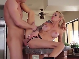 Young milf Sarah Jessie pulls out her big fake tits for Bill Bailey