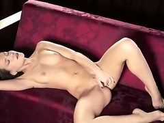 Totally naked charming brunette Sibul Arch shows off her sexy body as she...