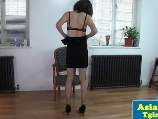 Thai shemale Naomi tugging in stockings