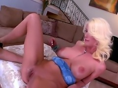 Fascinating big breasted blonde Riley Jenner flaunts her huge tits as she...