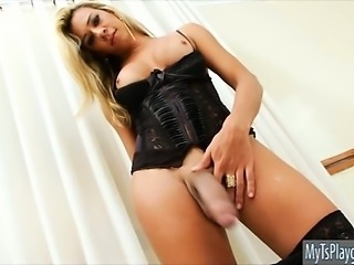 Lusty big boobs shemale in lingerie masturbates her big cock
