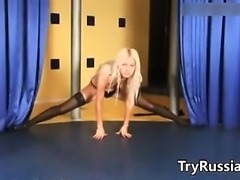 Blonde Russian Babe Doing A Striptease