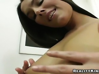 Brunette strips naked to give a close-up of her slit in solo scene
