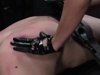 Busty mistress spanking dude in bdsm bondage handjob