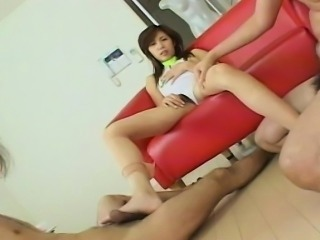 Asian lass foot fucks the dude before a wank