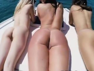 Sexy bikini beauties sucking dick on a boat