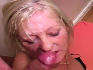 A mature blonde older woman being cummed over her face