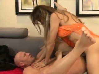 Horny mature shemale fucking with a guy on the couch