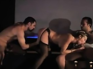 MILF In A Threesome With Two Guys At A Club