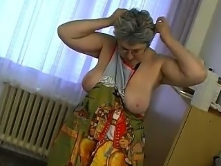 OmaPass Granny masturbate with cucumber in kitchen