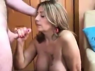 Busty MILF Sucking On A Guys Erect Cock