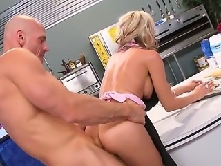 Milfy blonde Sindy Lange with fake boobs and hot ass gets her pretty tight pussy drilled by beefy hard dick from behind in the kitchen while cooking. She gets sexually used wit no mercy.