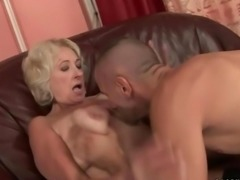 Busty fat grandma in black stockings gets fucked
