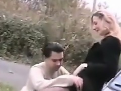 Couple Having Fun In And Out Of The Car