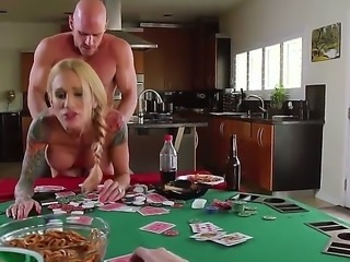 This hot and tattooed blonde porn star Sarah Jessie who likes cuckolding gets fucked on the table and in front of her husband. She sucks the big fat cock under the table and then offers him her shaved pussy.