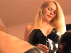 Two slaves and a blonde doing kinky stuff