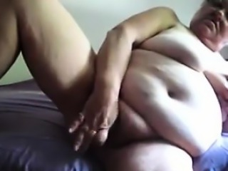 Big Granny Masturbating With A Dildo