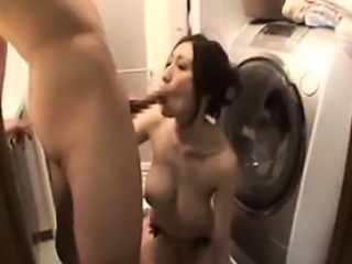 Busty Japanese MILF Sucking On A Cock