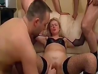 Horny older men fuck and fist an extremely adventurous blondie