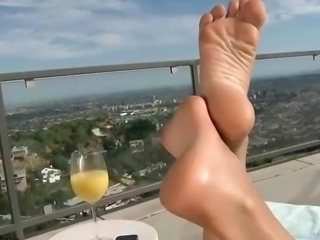 Exotic beauty gets her nice feet worshipped and fucked