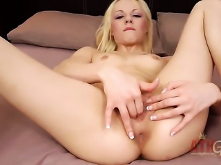 Blonde April Paisley with tiny tits and bald muff bares it all and masturbates in closeup
