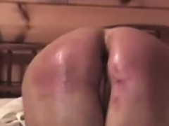 Spanking my slave a real soar and red butt