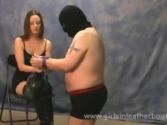Hot leggy mistress ties up slave for bondage and sexy leather boot worship