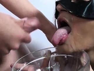 Masked slut takes jizz shots in her dirty mouth