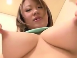 Japanese MILF Squeezes Out Lots Of Milk