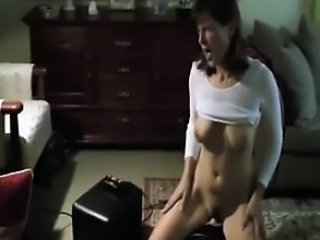 Horny Housewife Riding On Her Machine