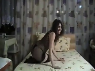 Cute Russian Woman In Lingerie On The Bed