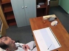 Slim brunette takes doctors dick in an office