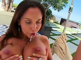 Big racked MILF brunette Ava Addams gives throat job to thick dicked guy and hen gets her massive melons banged. He loves her huge knockers and she loves his fat throbbing cock.