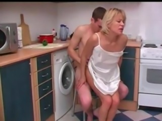 Russian mother with her son. Sex in the kitchen. free